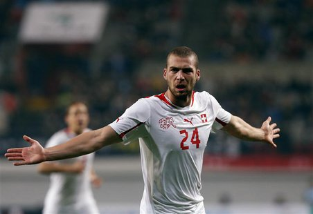 Switzerland's Pajtim Kasami (C) celebrates after scoring a goal against South Korea during their friendly soccer match at the Seoul World Cu
