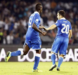 Italy's Mario Balotelli (L) celebrates with Giuseppe Rossi after scoring against Armenia during their 2014 World Cup qualifying soccer match