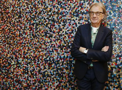 "Fashion designer Paul Smith poses after an interview with Reuters at the media launch of the exhibition ""Hello, My Name is Paul Smith"", at t"