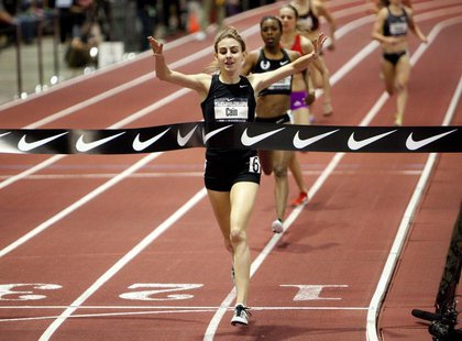 Mary Cain, 16, celebrates as she wins the women's 1 mile run finals at the USA Indoor Track and Field Championships in Albuquerque, New Mexi
