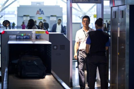 A traveler walks through a metal detector at a security check point in John F. Kennedy Airport in New York, February, 29, 2012. REUTERS/Andr