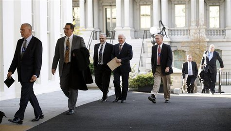 Health insurance chief executives arrive at the White House to meet with U.S. President Barack Obama in Washington November 15, 2013. REUTER