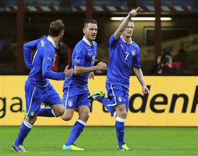Italy's Ignazio Abate (R) celebrates after scoring against Germany during their international friendly soccer match at the San Siro Stadium