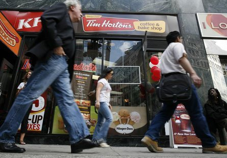 Pedestrians walk past a new Tim Hortons coffee and bake shop in Midtown Manhattan section of New York July 13, 2009. REUTERS/Brendan McDermi