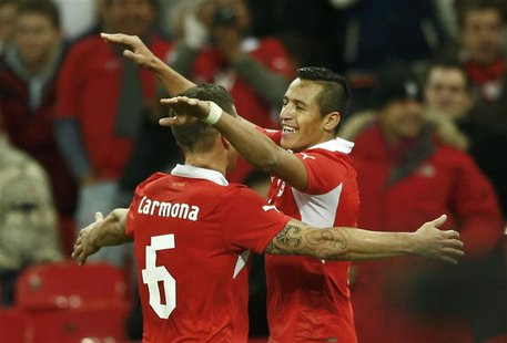 Chile's Alexis Sanchez (R) celebrates a second goal against England's with team mate Carlos Carmona (L) during their international friendly