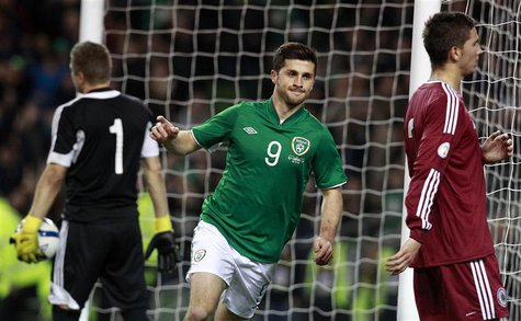 Ireland's Shane Long (C) celebrates after scoring against Latvia during their international friendly soccer match at the Aviva Stadium in Du