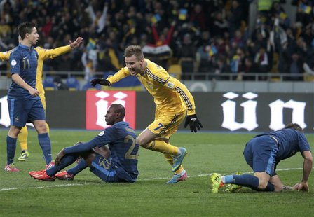 Ukraine's Andriy Yarmolenko (2nd R) celebrates a goal scored by his team mate Roman Zozulya (not pictured) during their 2014 World Cup quali