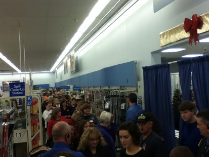 This is just the front of the line to meet Sarah Palin at Walmart in Rib Mountain 11/14/13.  From the back corner, the line goes left to the front of the store, and weaves through several departments.