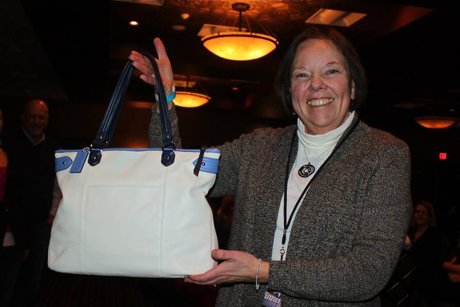 Happy with a purse she won on WIXX!