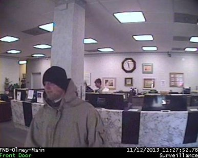 security camera photo of Olney bank robber