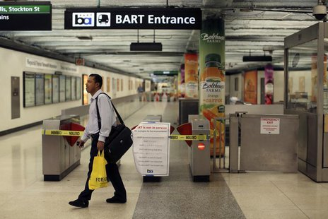 A man turns away at the Powell Street station after learning of a strike by employees of the Bay Area Rapid Transit (BART) in San Francisco,