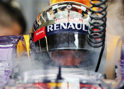 Red Bull Formula One driver Sebastian Vettel of Germany is sprayed with dried ice to keep cool during the third practice session of the Aust