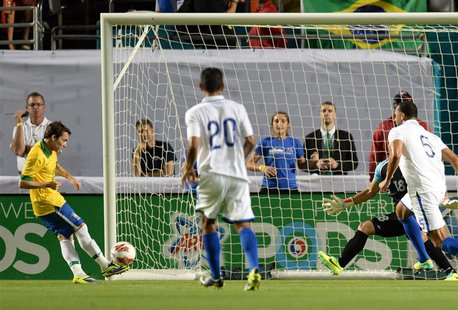 Nov 16, 2013; Miami Gardens, FL, USA; Brazil forward Bernard (20) scores a goal against Honduras during the first half at Sun Life Stadium.