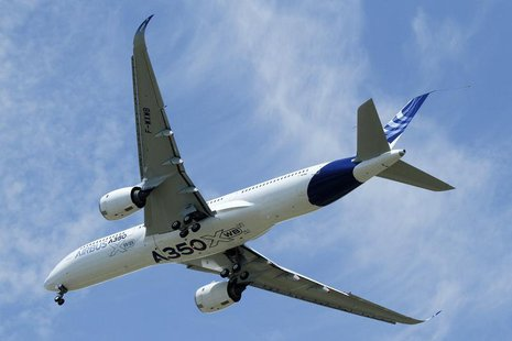 The new Airbus A350 flies over Toulouse-Blagnac airport during its maiden flight in southwestern France, June 14, 2013. REUTERS/Jean-Philipp