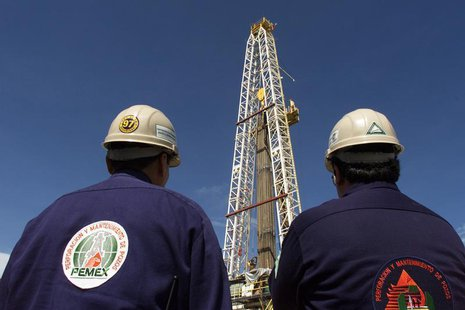 Two engineers with Mexico's state owned oil company, PEMEX (Petroleos de Mexico), watch work on an oil platform in the Sen oil field, in the