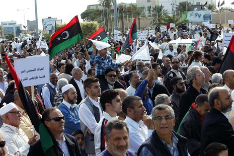 Protesters march during a demonstration calling on militiamen to leave, in Tripoli November 15, 2013. REUTERS/Ismail Zitouny (