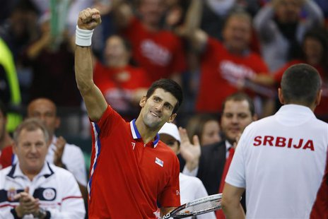 Serbia's Novak Djokovic celebrates winning a set against Czech Republic's Tomas Berdych during their Davis Cup World Group final tennis matc