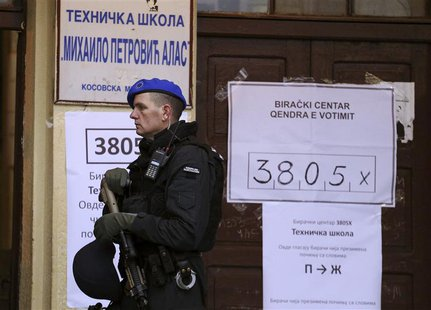 A European Union policeman secures a polling station in the northern part of the ethnically-divided town of Mitrovica November 17, 2013, NAT