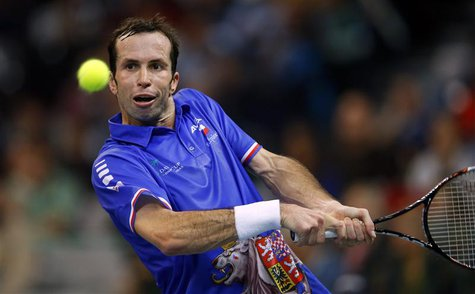 Czech Republic's Radek Stepanek returns the ball to Serbia's Dusan Lajovic during their Davis Cup World Group final tennis match in Belgrade