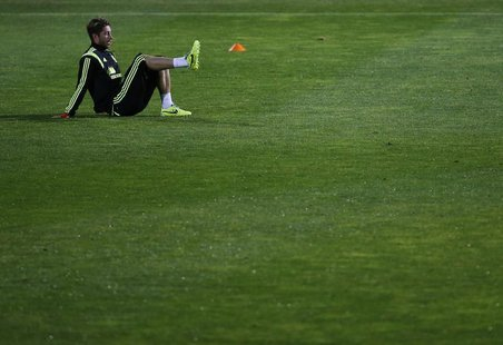 Spain national player Sergio Ramos takes part in a soccer training session at Soccer City in Las Rozas, near Madrid, November 13, 2013. REUT
