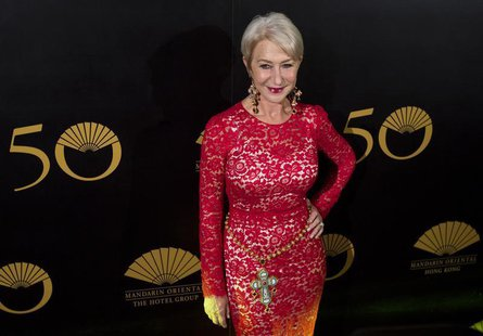 British actress Helen Mirren poses on the red carpet as she arrives at an event celebrating the 50th anniversary of the Mandarin Oriental ho