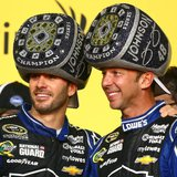 Nov 17, 2013; Homestead, FL, USA; NASCAR Sprint Cup Series driver Jimmie Johnson (left) celebrates with crew chief Chad Knaus after winning
