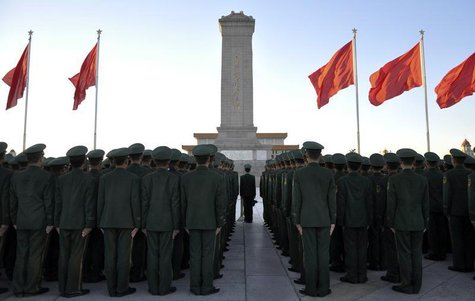 Paramilitary policemen stand in formation as they pay tribute to the Monument to the People's Heroes on Tiananmen Square in Beijing, Novembe