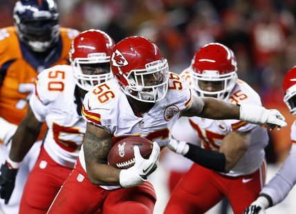 Nov 17, 2013; Denver, CO, USA; Kansas City Chiefs inside linebacker Derrick Johnson (56) returns a fumble in the first quarter against the D