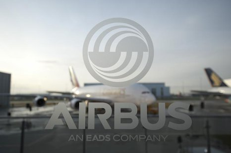 An A380 aircraft is seen through a window with an Airbus logo during the EADS / Airbus 'New Year Press Conference' in Hamburg January 17, 20