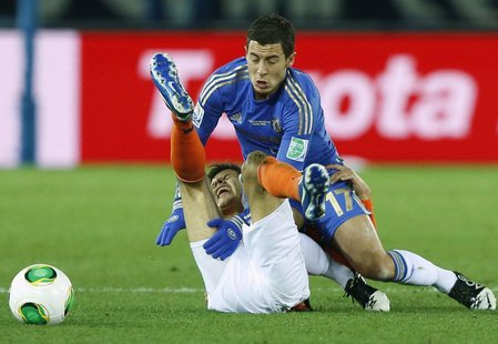 Eden Hazard (R) of Britain's Chelsea and Jesus Corona of Mexico's Monterrey fight for the ball during their Club World Cup semi-final soccer