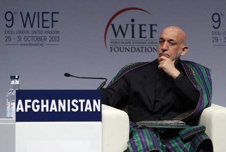 Afghanistan's President Hamid Karzai listens to an address during the World Islamic Economic Forum in London October 29, 2013. REUTERS/Luke