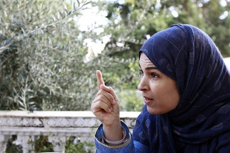 Hayet Saadi, mother of Aymen Saadi, speaks during an interview with Reuters in Tunis November 13, 2013.REUTERS/Anis Mili