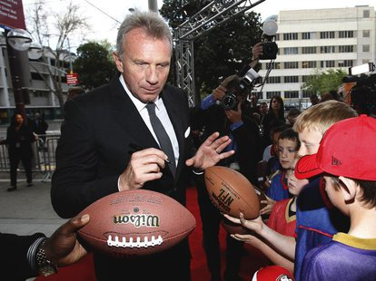 Inductee and former San Francisco 49'ers quarterback Joe Montana signs autographs as he arrives at the 7th Annual California Hall of Fame in