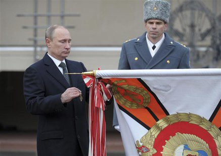 Russia's President Vladimir Putin (L) takes part in a ceremony to award the Margelov Ryazan Higher Airborne Command School with the Order of