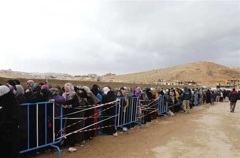 Syrians, fleeing the violence from the Syrian town of Qara, queue to register to get help from relief agencies at the Lebanese border town o