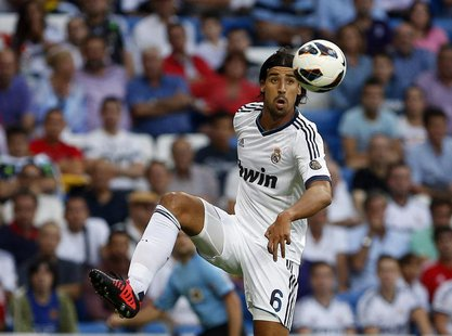 Real Madrid's Sami Khedira controls the ball during their Spanish first division soccer match against Granada at the Santiago Bernabeu stadi
