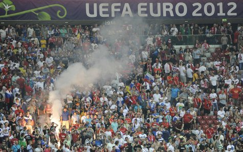 Russia's soccer fans react after defeat at the Group A Euro 2012 soccer match against Greece at National stadium in Warsaw, June 16, 2012. R