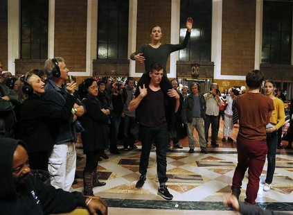 "Members of the L.A. Dance Project perform the opera ""Invisible Cities"" at the Amtrak's Union Station in Los Angeles November 15, 2013. REUTE"