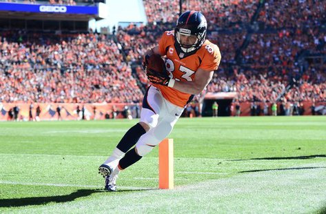 Oct 27, 2013; Denver, CO, USA;Denver Broncos wide receiver Wes Welker (83) scores a touchdown in the first quarter against the Washington Re