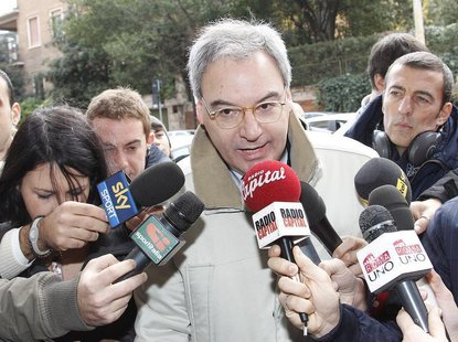 Italian Serie A president Maurizio Beretta (C) talks to reporters as he arrives to attend a meeting in Rome December 7, 2010. REUTERS/Tony G