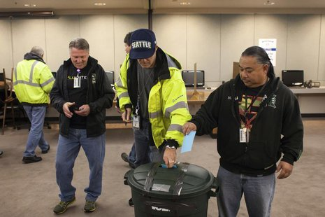 Union members cast their ballots at the International Association of Machinists District 751 Headquarters during a union vote in Seattle, Wa