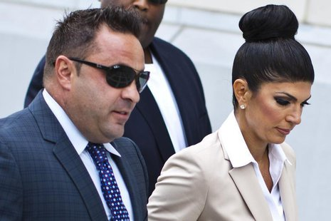 "Teresa Giudice, 41, and her husband Giuseppe ""Joe"" Giudice, 43, arrive at the federal court in Newark, New Jersey August 14, 2013. REUTERS/E"