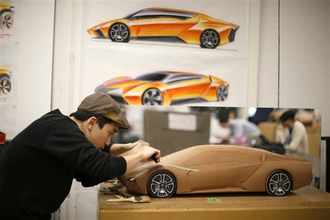 Junghan Kim, 22, from South Korea, works on a clay design for a 2023 Lamborghini during a Transportation Design class at Art Center College