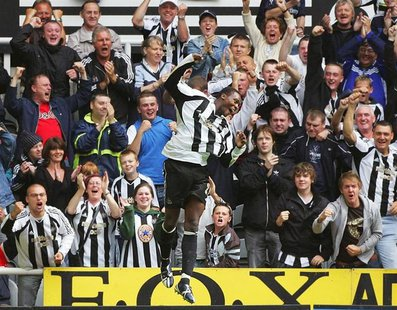 Newcastle United's Shola Ameobi (C) celebrates scoring the winning goal against Wigan Athletic during their English Premier League soccer ma