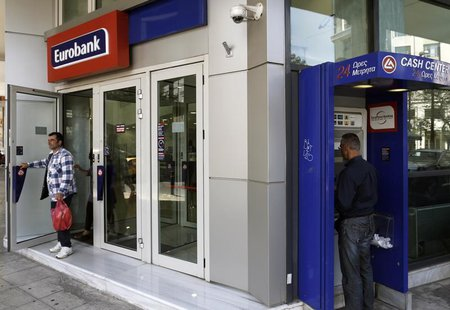 A customer leaves a Eurobank branch in Athens April 10, 2013. REUTERS/John Kolesidis