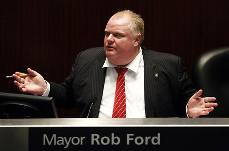 Toronto Mayor Rob Ford attends a special council meeting at City Hall in Toronto November 18, 2013. REUTERS/Aaron Harris