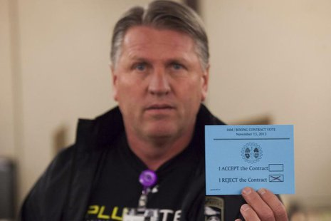 A union member displays his vote against the proposed contract during a union vote at the International Association of Machinists District 7