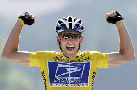 U.S. Postal Service Team rider Lance Armstrong of the United States raises his arms as he crosses the finish line to win the 204.5 km long 1