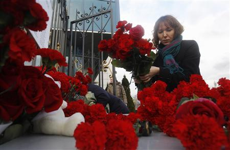 A woman lays flowers near a fence of Kazan airport, where a Tatarstan Airlines Boeing 737 crashed, November 18, 2013. A Boeing 737 airliner crashed on Sunday in the Russian city of Kazan, killing all More... CREDIT: REUTERS/MAXIM SHEMETOV