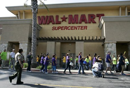 Walmart workers on strike walk a picket line during a protest over unsafe working conditions and poor wages outside a Walmart store in Pico